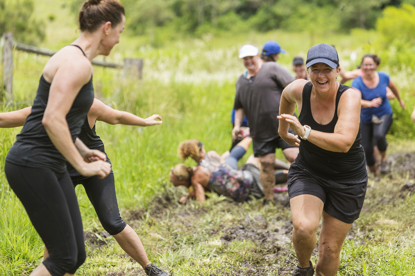 Mud Covered Mature Women in an Obstacle Course Bog